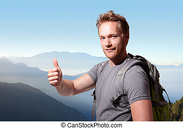 happy man mountain hiker with backpack and show thumb up on...