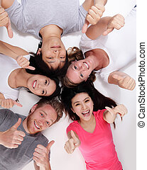 Happy Group of friends lying and making a circle, asian and...