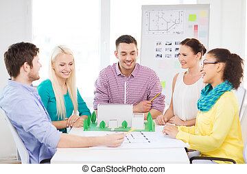 smiling architects working in office - startup, education,...