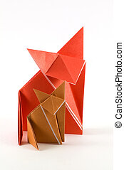 Fox Origami - Two origami fox, made of orange and brown...