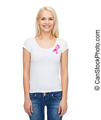 smiling woman with pink cancer awareness ribbon - healthcare...