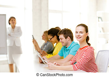 female student with classmates in computer class -...