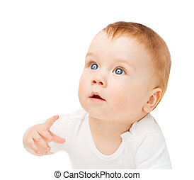 curious baby lying on floor and looking up - child and...