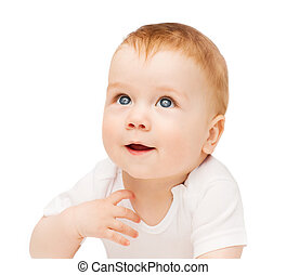 smiling baby lying on floor and looking up - child and...