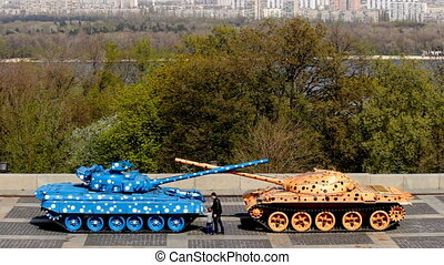 two painted tank