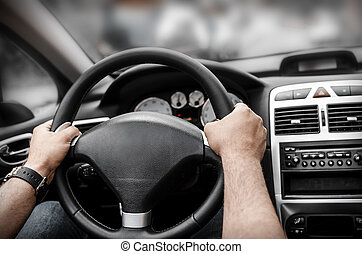 Car driver - Man driving his car. Hands holding the wheel.
