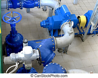 Water pumping station, industrial interior and pipes. Water...