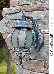 Old Lantern - Old lantern hooked on a stone wall