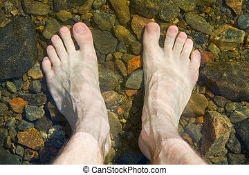 bare feet on shoal of lake - Bare feet on shoal of pure lake