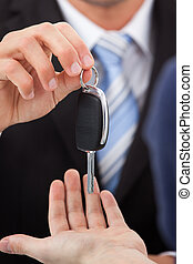 Agent Giving Car Key To Man