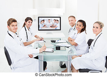 Doctors Attending Video Conference - Team of doctors...