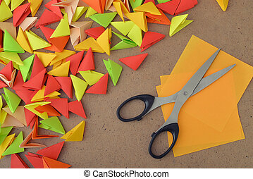 Colorful modules origami on wooden background closeup