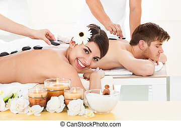 Couple Receiving Lastone Therapy - Young couple receiving...