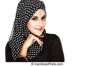 Fashion portrait of young beautiful muslim woman with black...