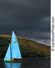 Sailing Boat in a Loch - A Sailing Boat, under a brooding...