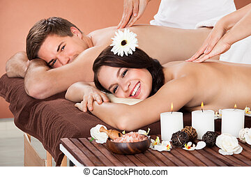 Couple Receiving Shoulder Massage At Spa - Portrait of...