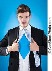 Confident Superhero Businessman Tearing Suit - Portrait of...
