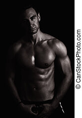 nude man - portrait of handsome nude man over dark...
