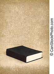 Black book on the fabric background