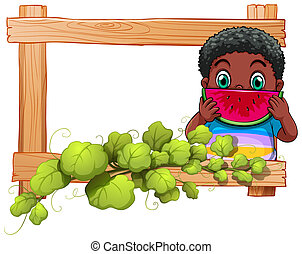 A wooden frame with a boy eating watermelon