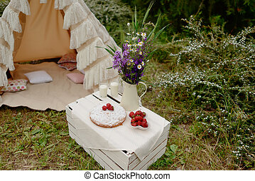 picnic in a tent - nature white tent on a bouquet of flowers...