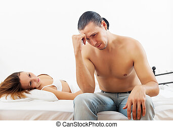 Middle-aged couple having problem in bed