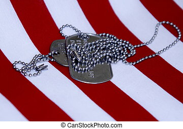 Country Served - American soldiers dog tags on red and white...