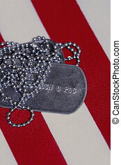 Veterans Pride - Dog Tags on top of an American Flag red and...