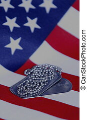 Stars and Stripes - Close up of Military Dog Tags on...