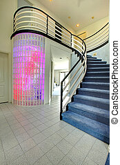 Modern foyer with glass block wall trim