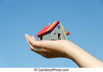 house in palm on blue sky house purchase concept - house...