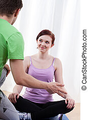 Trainer giving advice - Male trainer giving advice to young...