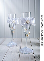 two wedding ornated empty wineglasess