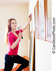 Positive  girl in red hanging  pictures