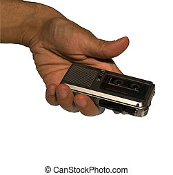 Microcassette recorder - A male hand holding a microcassette...