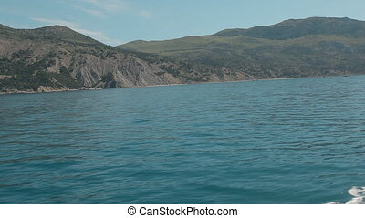 Coast of Crimea. Black Sea from the speed boat on a sunny...