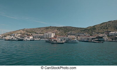 View Balaklava with a yacht that comes into the bay Genoese...