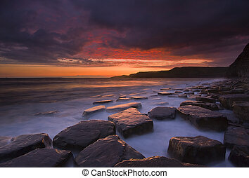 Crimson sunset at Kimmeridge - the sky clears after a rain...