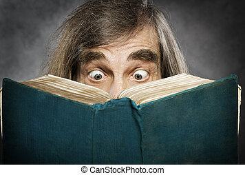 Senior reading open book, surprised old man, amazing eyes...