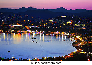 View of Gumbet Bay by night. Turkish Riviera.