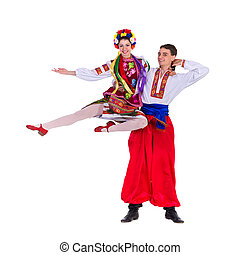 beautiful dancing couple in ukrainian polish national...