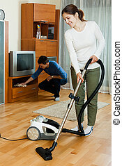 family doing housework together in home - Ordinary family...
