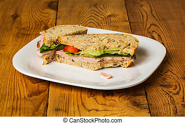 English multigrain bread ham sandwich with bite - English...