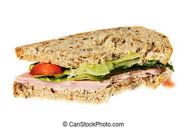 English multigrain bread ham sandwich with bite - Isolated...