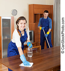 Professional cleaners in uniform - Team of professional...