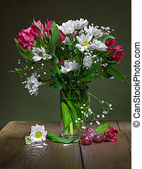 Still life of flowers alstroemeria and camomiles in a glass...