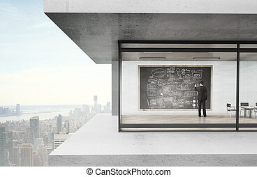 businessman drawing businessplan in loft house