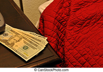money on the bed - a stack of bills on a bed
