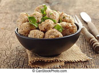 Roasted meatballs in a bowl