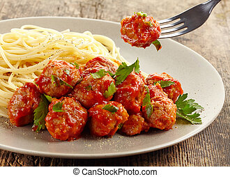 Meatballs with tomato sauce and spaghetti on plate